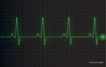 Ein grüner EKG Ausschlag auf schwarzen Grund